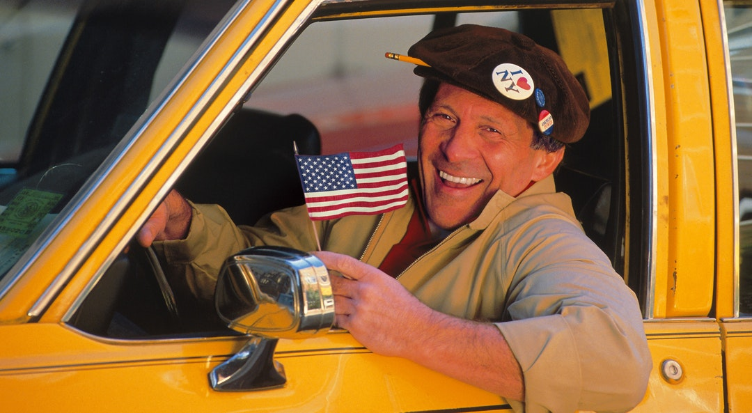 taxi man american flag cat