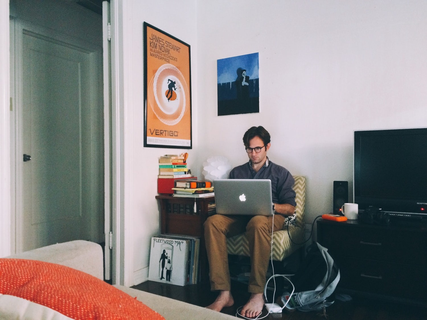 a young man using a laptop in his living room t20 knloPX